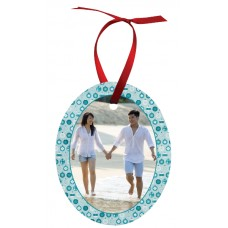 Oval Metal Ornament With Red Ribbon
